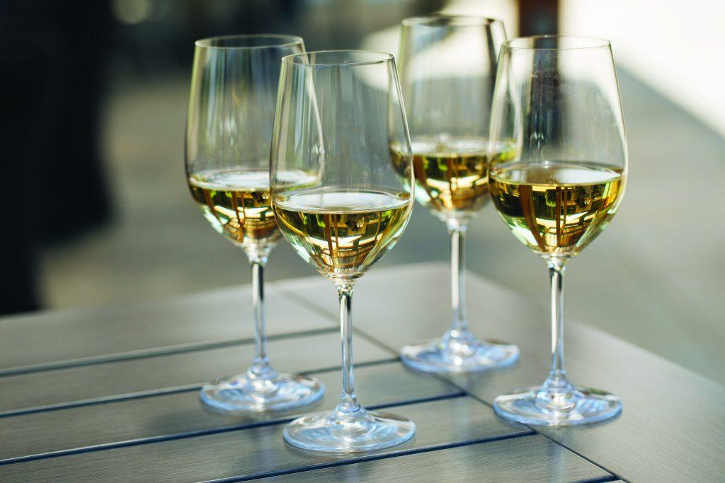 four glasses of white wine